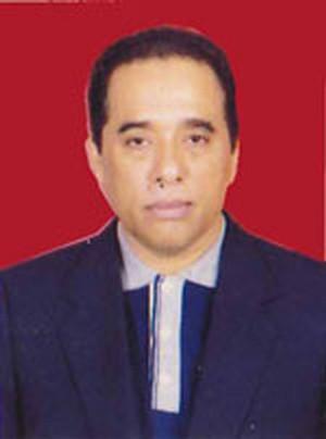 DR. H. Fachmi, SH, MH.
